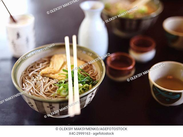 Bowl of Ramen with Soba noodles and tofu on a table in a Japanese restaurant, Kyoto, Japan