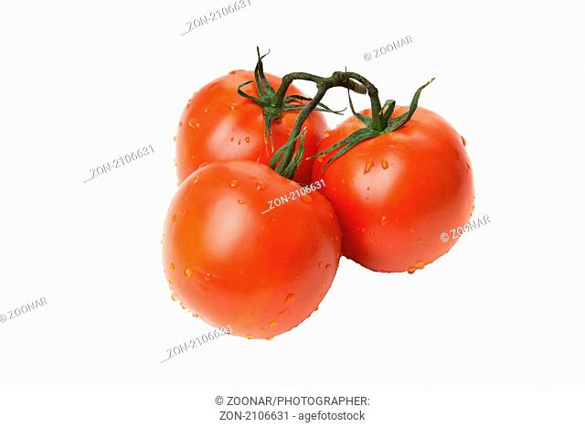 three red tomato isolated on white