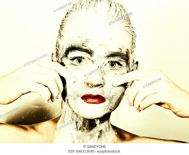 abstract art makeup. Face and neck girls smeared with gray colors and bright red lips. Holi Festival
