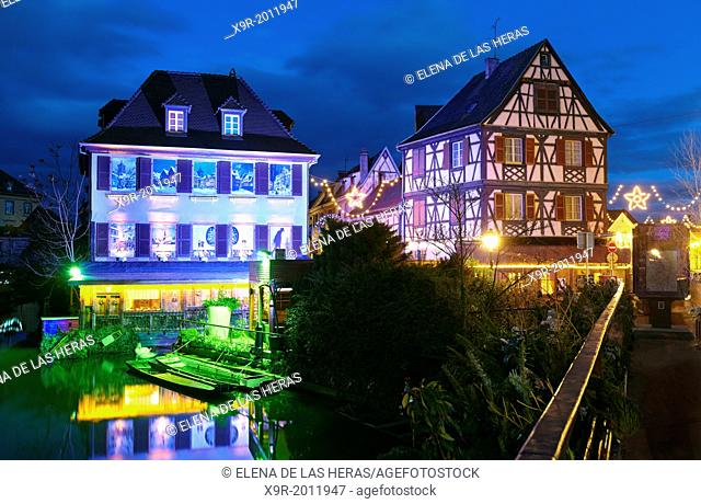 Christmas decoration by night at the Little Venice. Colmar. Wine route. Haut-Rhin. Alsace. France