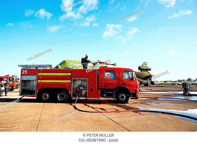 Firemen and fire engine in training centre, Darlington, UK