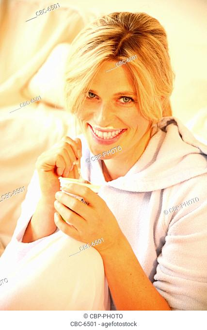Portrait of Young Woman Eating Yoghurt