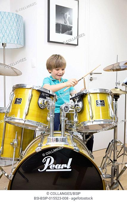 A child playing the drums