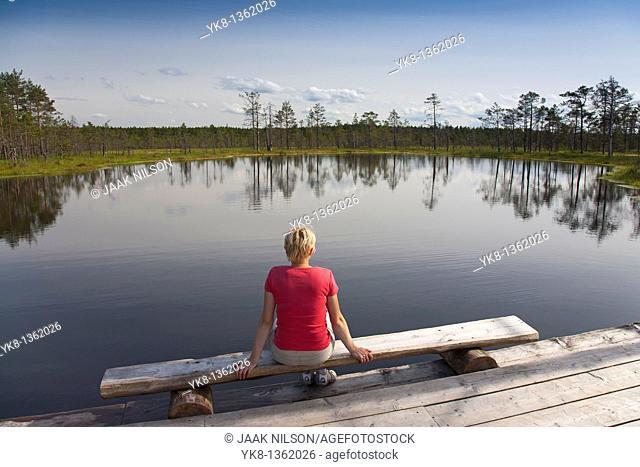 Young Woman Sitting by Bog Lake in Viru Bog, Lääne-Viru County, Estonia, Europe