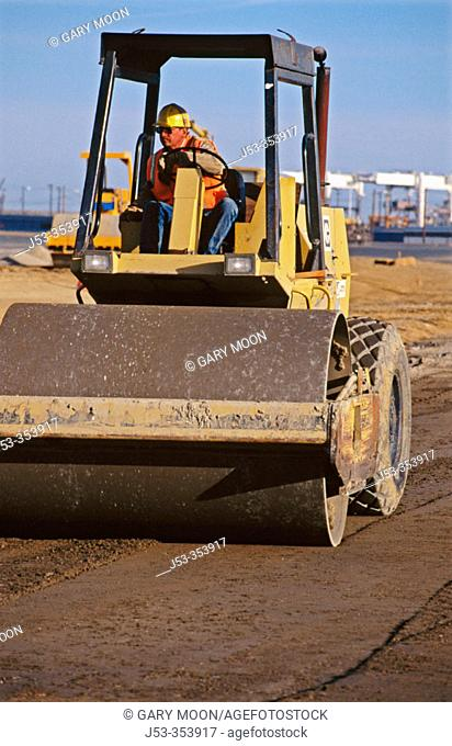Excavating machines, stabilizing roadbed. I-880 Cypress project. Oakland, California. USA
