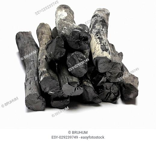 kishu binchotan, japanese traditional white charcoal isolated on white background