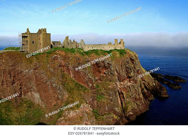 Dunnottar Castle is a ruined medieval fortress located upon a rocky headland on the north-east coast of Scotland, Aberdeenshire, Scotland