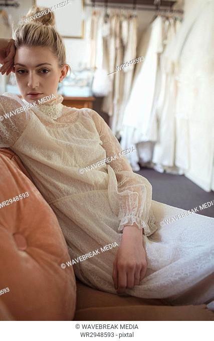 Portrait of young bride relaxing on sofa