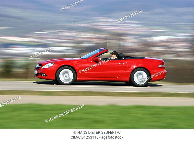 Mercedes SL 350, model year 2008-, red, driving, side view, country road, open top