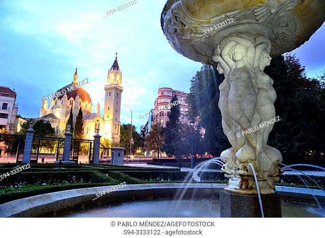 Fountain and Parish church of San Manuel and San Benito. Retiro, Madrid, Spain