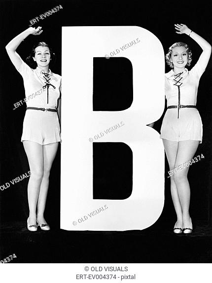 Women waving with huge letter B All persons depicted are not longer living and no estate exists Supplier warranties that there will be no model release issues