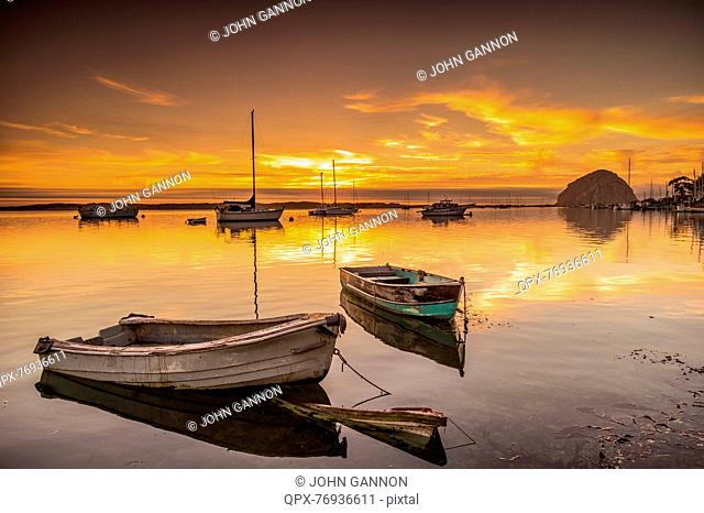 Sunset over Morro Bay with wooden boats, California, USA