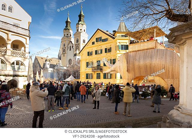 a view of the Dom square in the city of Brixen with a gigantic wood statue of the elephant called Soliman during the Christmas market, Bolzano province