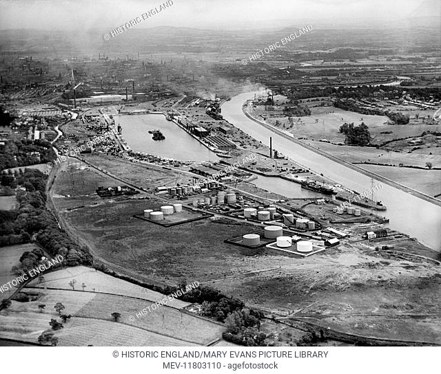 Preston Docks and the city from the north-west, Preston, Lancashire. Photographed by Aerofilms Ltd in July 1932