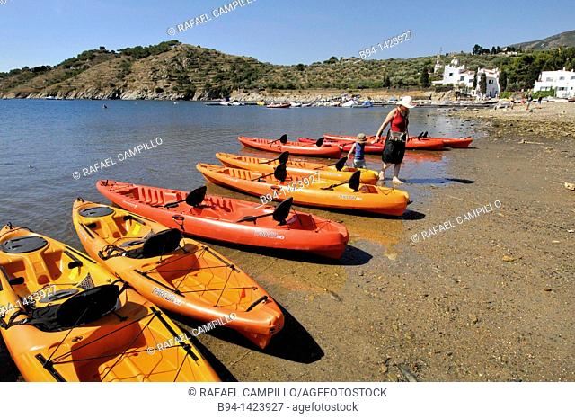 Canoes and Casa-Museo Salvador Dalí. Port Lligat, small village located in a small bay on Cap de Creus peninsula, on the Costa Brava of the Mediterranean Sea