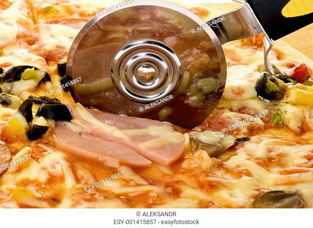 pizza with knife close up