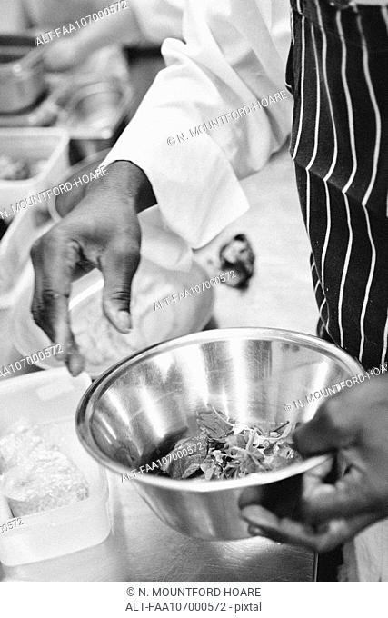 Chef preparing food in mixing bowl