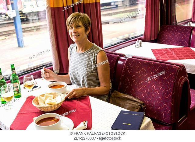 Tourist dining on the train from Budapest to Berlin