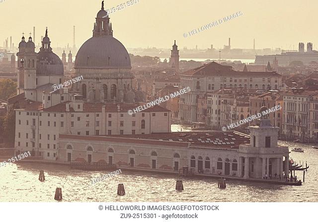 Bathed in sunset light the dome of Santa Maria Della Salute and the Punta Della Dogana, where the Giudecca Canal meets the Grand Canal, Venice, Veneto