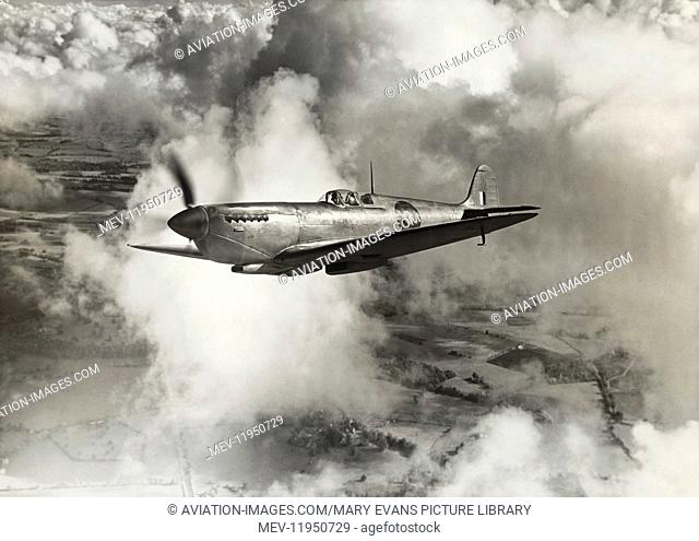 Royal Air Force RAF Photo-Reconnaissance Supermarine Spitfire 11 Flying Enroute over Cloud and Fields