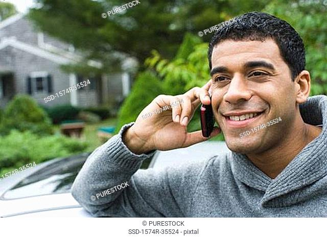 Man talking on mobile phone and smiling