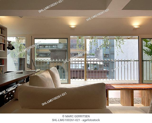 Living room with sliding glass doors to patio