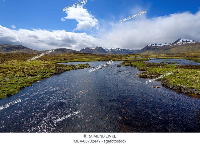 River in moor landscape with cloudy sky, Rannoch Moor, Scotland, United Kingdom