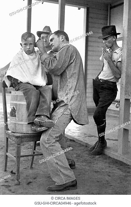 Boy Getting Haircut, Community Barber Shop, Migrant Camp, Kern County, California, USA, Dorothea Lange, Farm Security Administration, November 1936