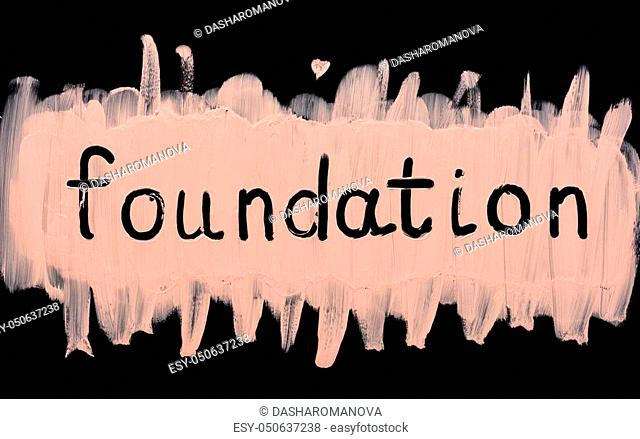 Close up of a make up liquid cream foundation on black background. Foundation text