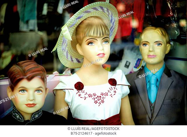 Three old fashioned dressed children mannequins. Southall, London, England, UK