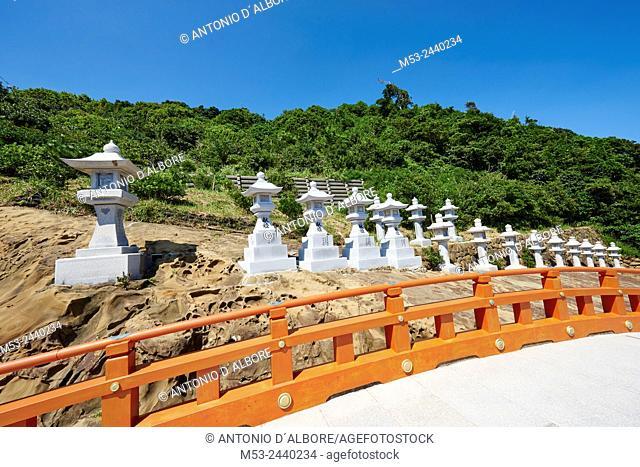 Japanese stone lanterns lined up at Udo-jingu, a taoist shrine in Nichinan City. Miyazaki Prefecture. Japan