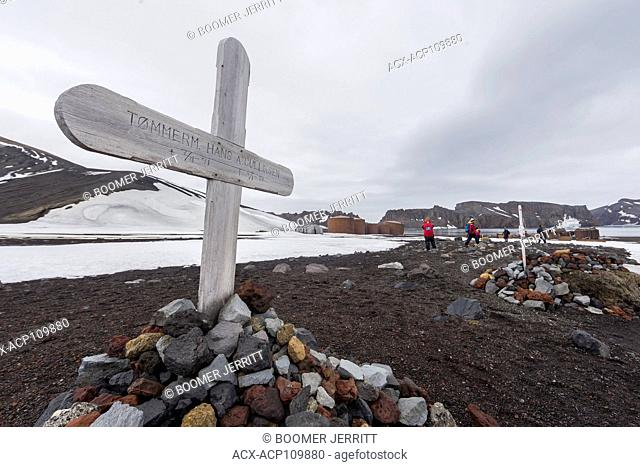 A lonely grave marker juts up into a featureless sky at Whalers Bay on Deception Island. South Shetland Island