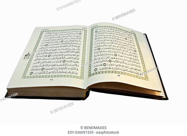 Open Koran with arabic writing visible