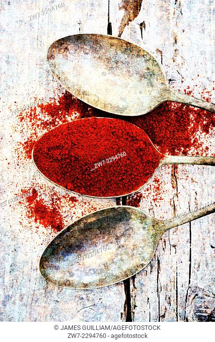 Paprika with antique spoons
