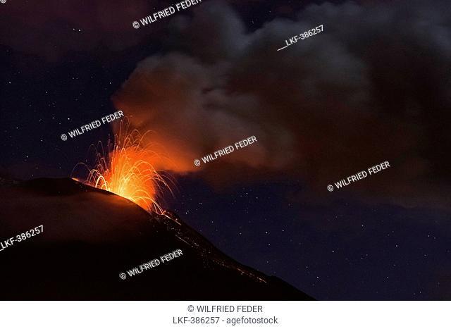 Volcano Tungurahua eruption at night, seen from Banos, Ecuador, South America