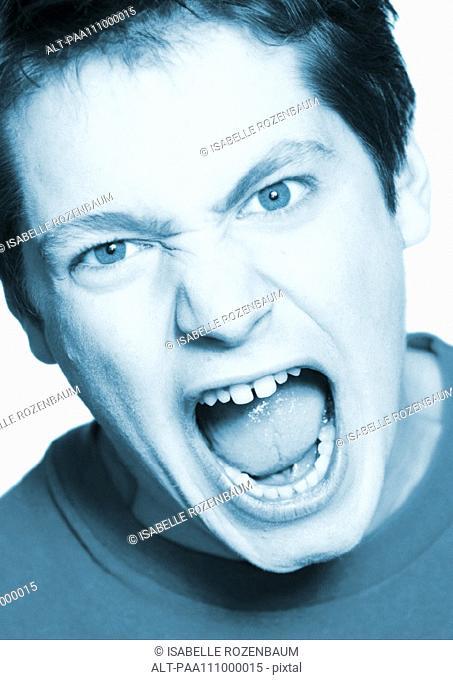 Teenage boy shouting, close-up, portrait