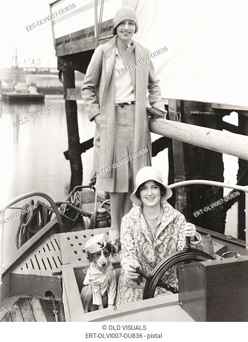 Two women out sailing with their mascot (OLVI007-OU836-F)