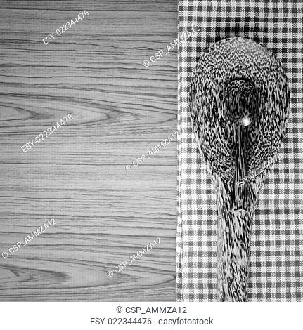 kitchen towel with spoon on wood background black and white color tone style