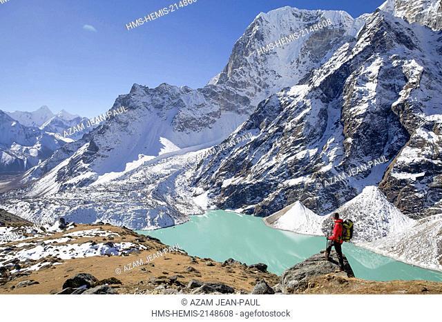 Nepal, Sagarmatha National Park, listed as World Heritage by UNESCO, Solu Khumbu District, hiker near Cholatse 6335 m et Tabuche 6367 m peaks, Chola Tsho lake