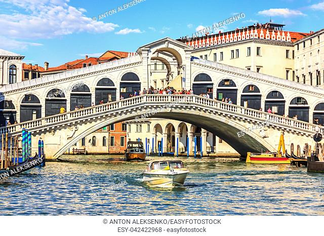 The Rialto Bridge of Venice with gondolas, vaporetto and boats underneath