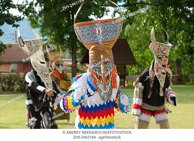 People dressed up with ghost masks and colourful costume. Phi Ta Khon masks Festival, which is annually held in the 7th lunar month (June)