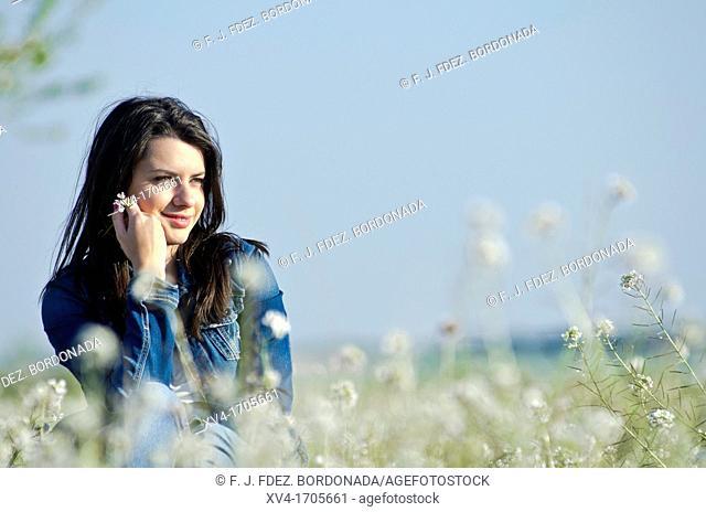 Beautiful girl relaxing in countryside
