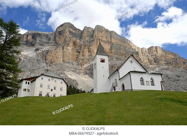 Alta Badia, Dolomites, South Tyrol, Italy. The Crusc, the church of Santa Croce in Alta Badia. In background the west face of Sasso di Santa Croce