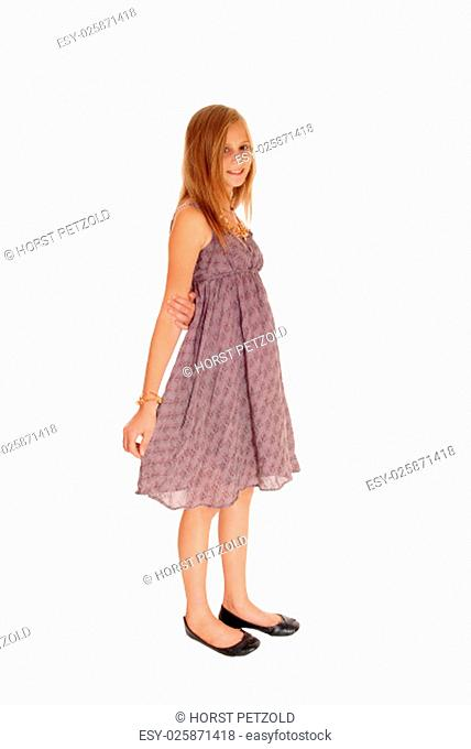 A beautiful little girl standing in a burgundy dress isolated for white.background.
