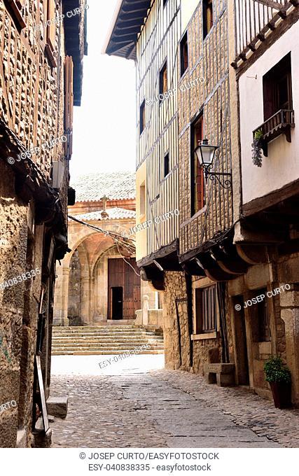 streets and entrance of La Asuncion church, La Alberca, Salamanca province,Castilla-Leon, Spain