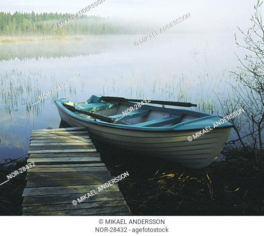 A rowing boat by a small berth  Sweden