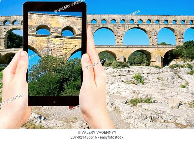 tourist taking photo of Pont du Gard