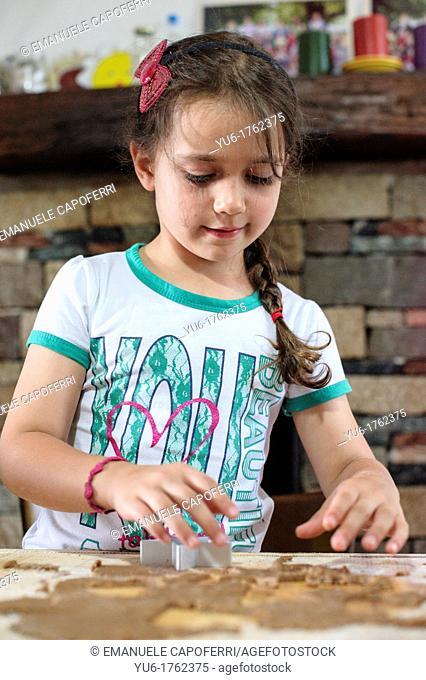 Children prepare cookies in the kitchen