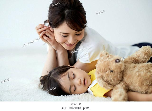Japanese mother with sleeping kid