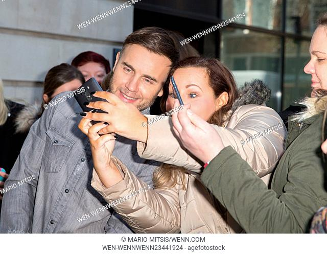 Gary Barlow mobbed by fans to get selfies as he leaves the Radio 2 studio Featuring: Gary Barlow Where: London, United Kingdom When: 02 Feb 2016 Credit: Mario...